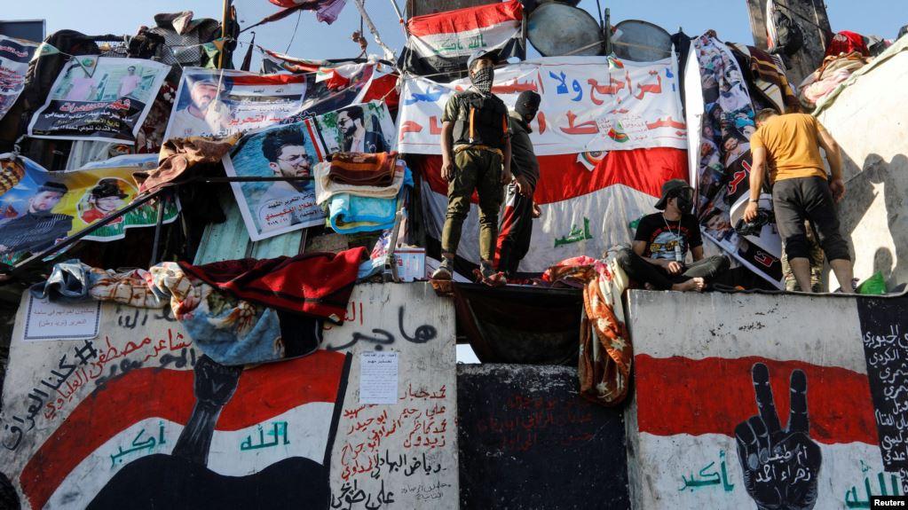 """""""معتصمو ساحة التحرير"""" يصدرون بيانا بعد مصادمات مع """"القبعات الزرق"""""""